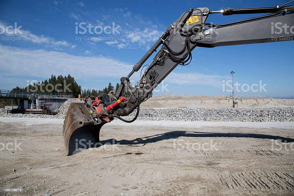 Excavator with a scoop royalty-free stock photo