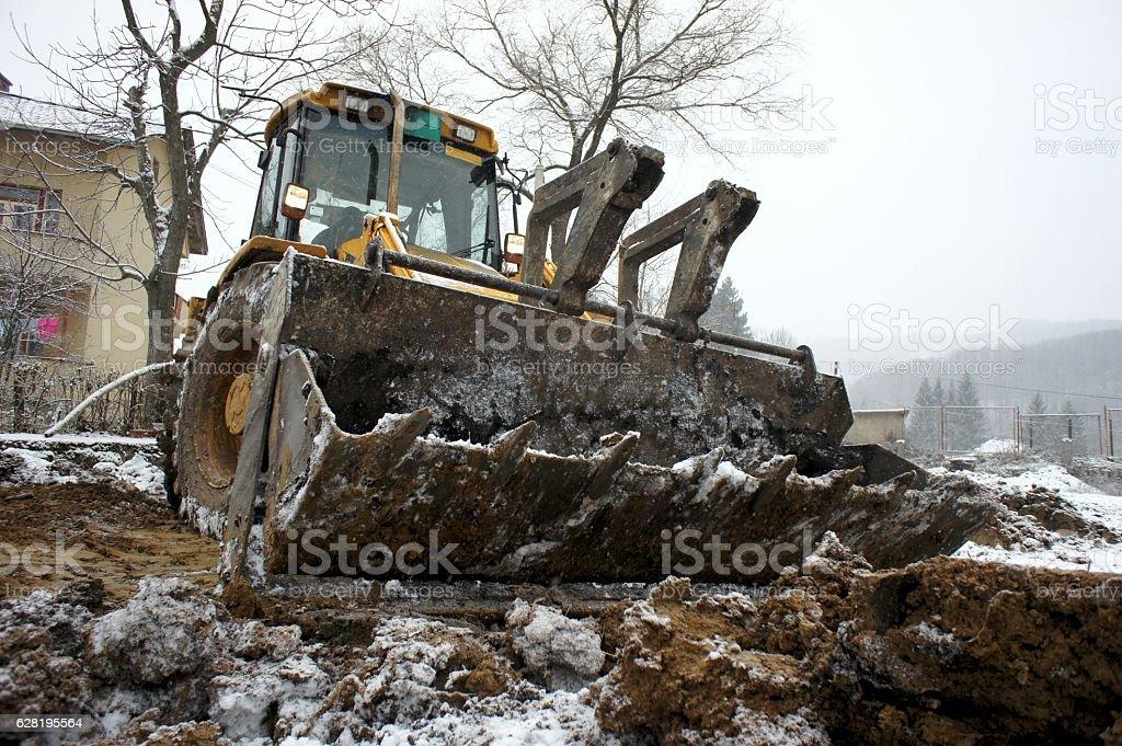 Excavator with backhoe stock photo