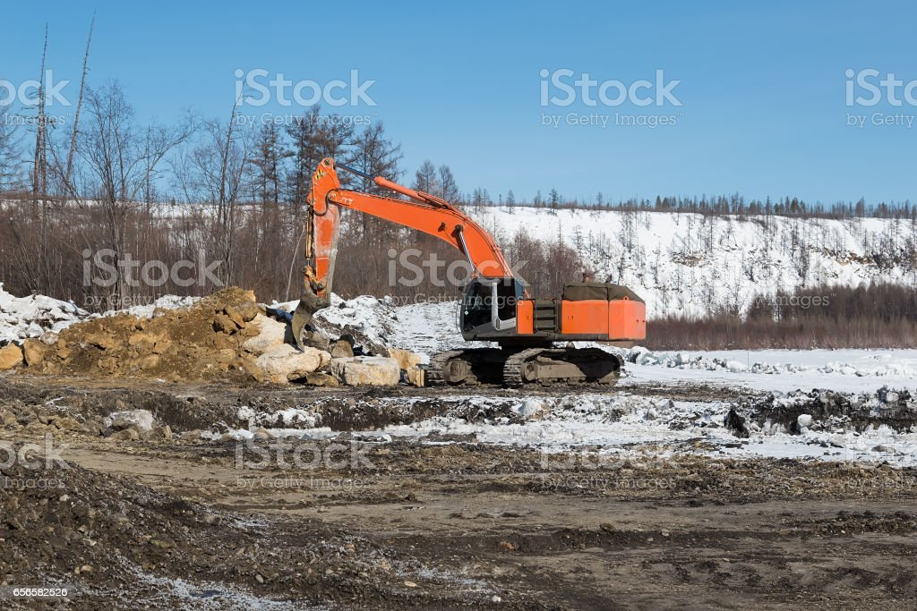 Excavator with fang-ripper stock photo