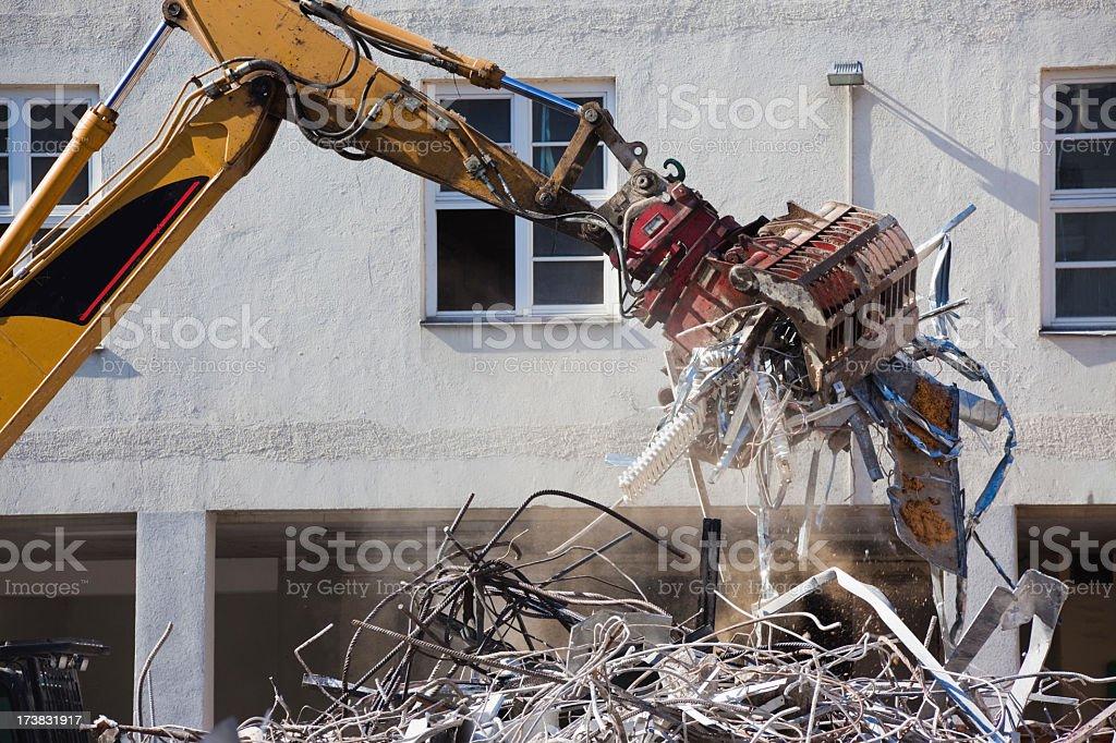 Excavator with grab moving metal scrap royalty-free stock photo