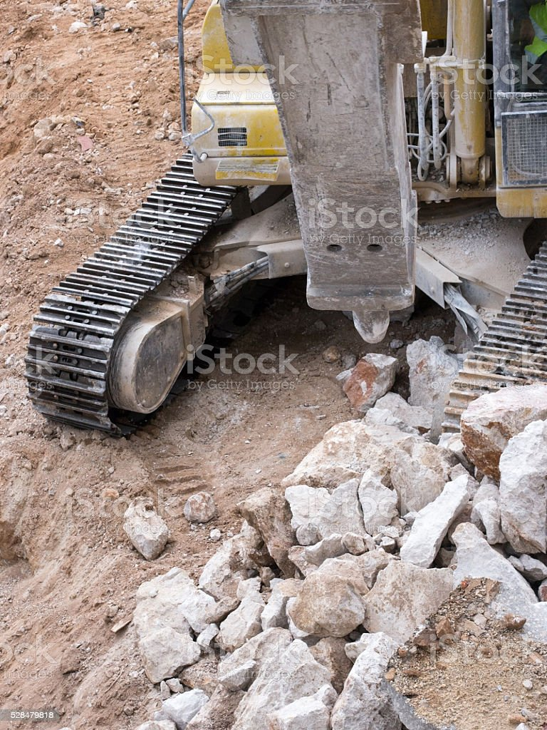 Excavator with hammer close up stock photo