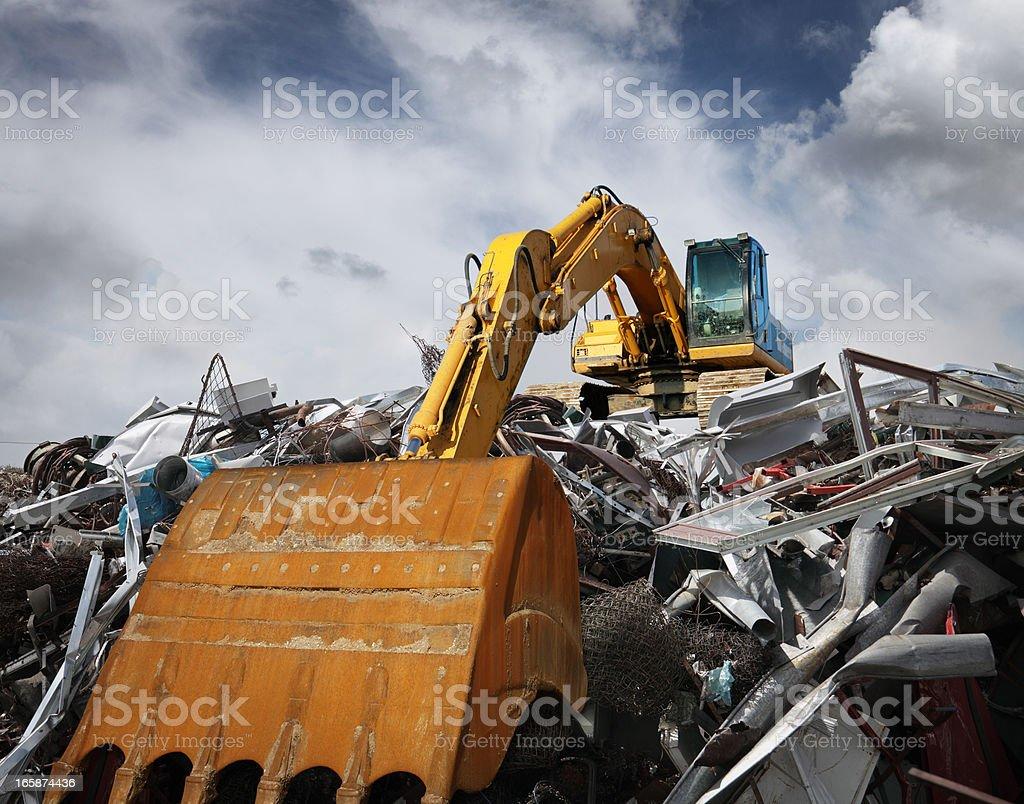 Excavator working at garbage dump stock photo