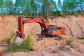 Excavator working in sand quarry