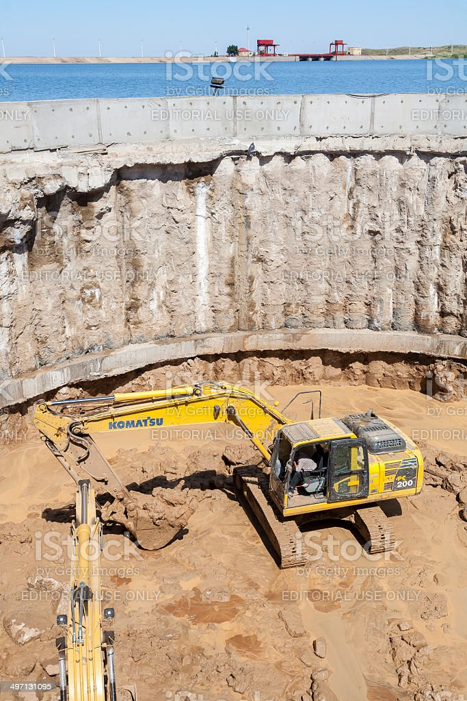 Excavator working in very big hole stock photo