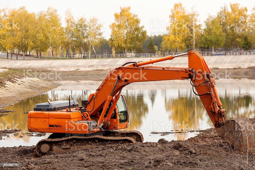 Excavator working on the autumn nature stock photo