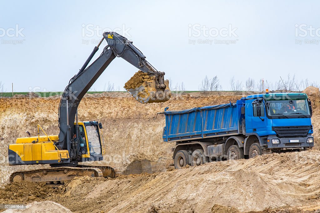 Excavator working on the construction site stock photo