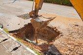 Excavator working on the Repair of pipe water
