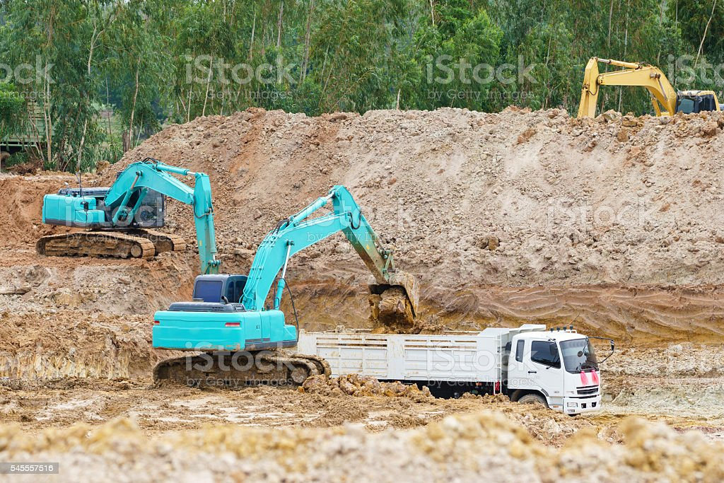 excavator working removing earth on a construction site. stock photo