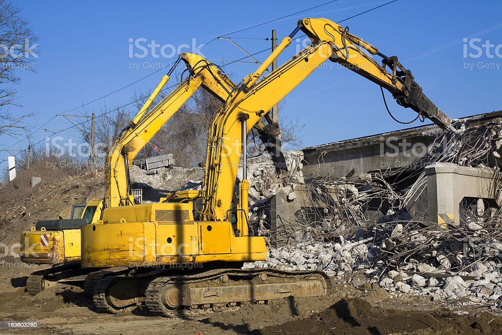 Excavators destroy the old viaduct stock photo