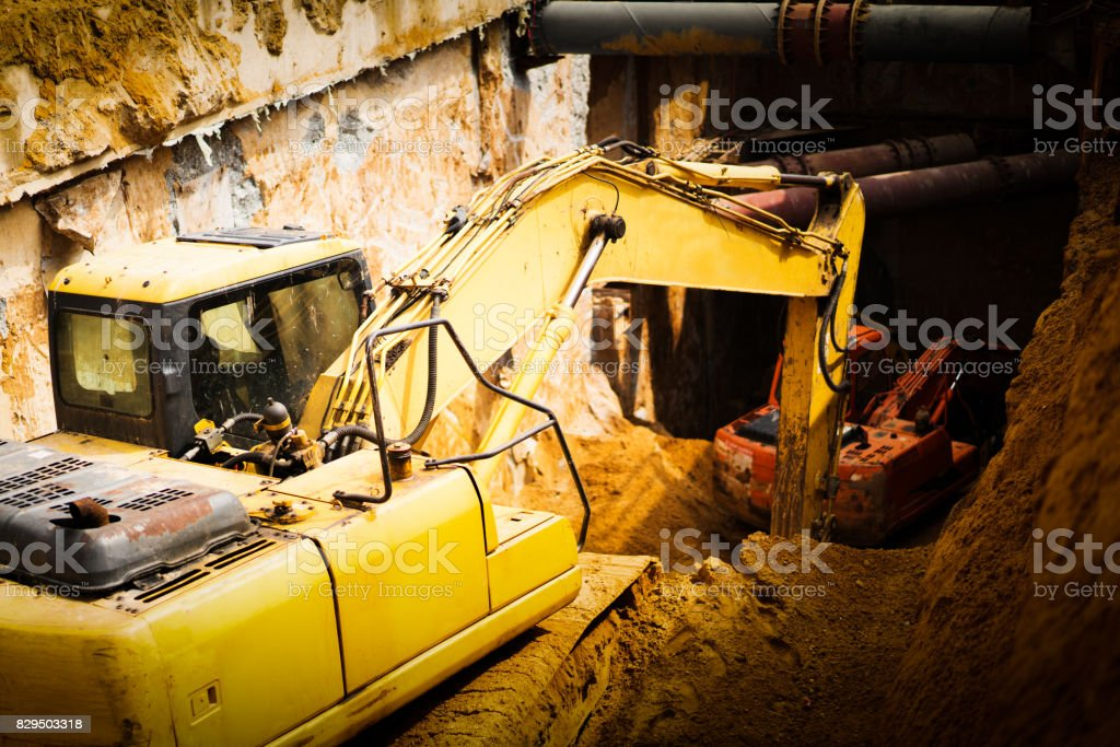 Excavators machine in construction site on sky background stock photo