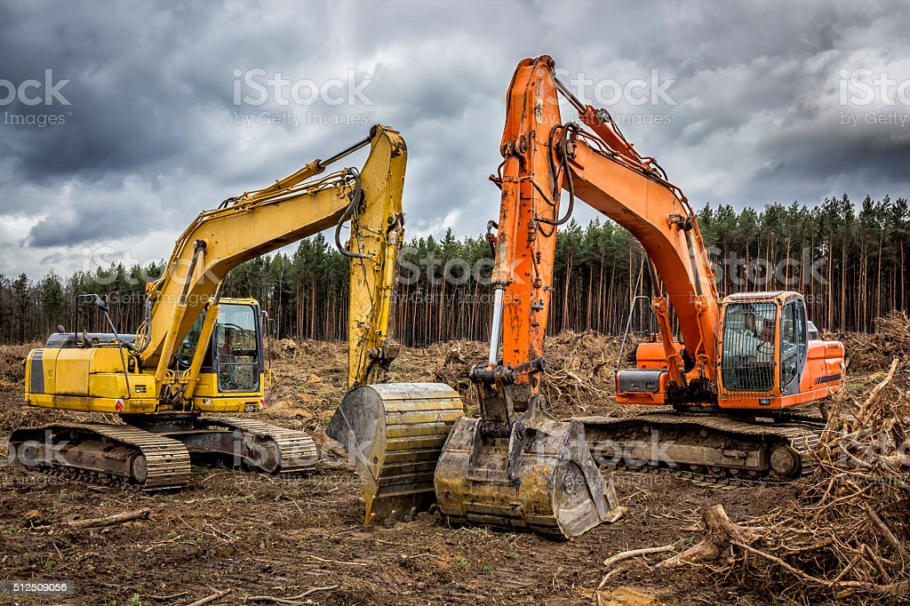 Excavators on a new road construction stock photo