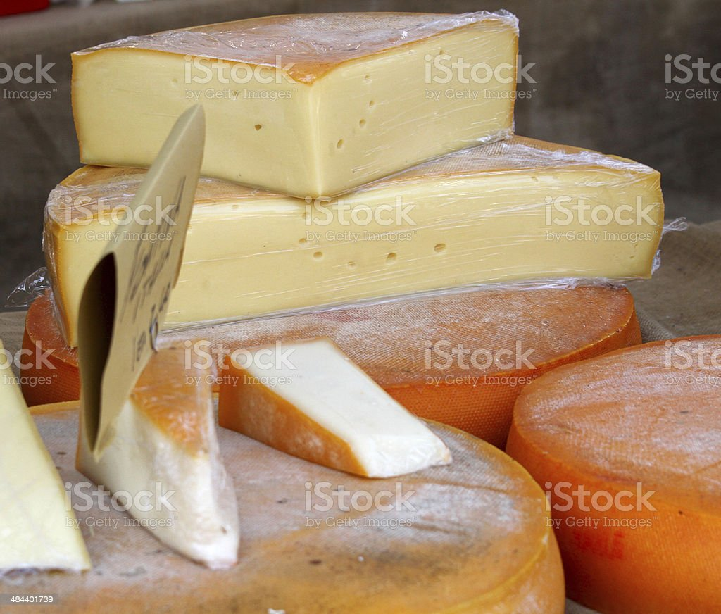 excellent cheese on sale from milkman into a village fair stock photo