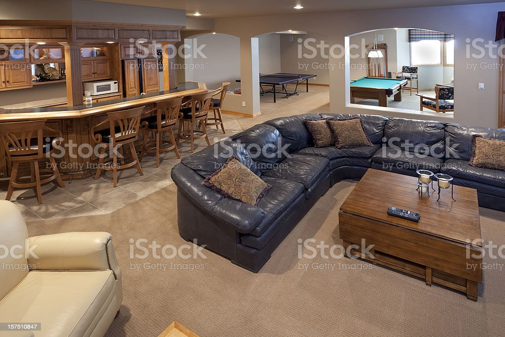 Excellent Finished Basement Bar, Lounge, Game Room, Pool Table, Sofa stock photo