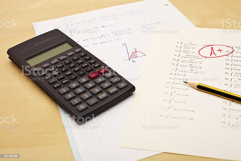 Excellent grades on exam of maths and calculator royalty-free stock photo