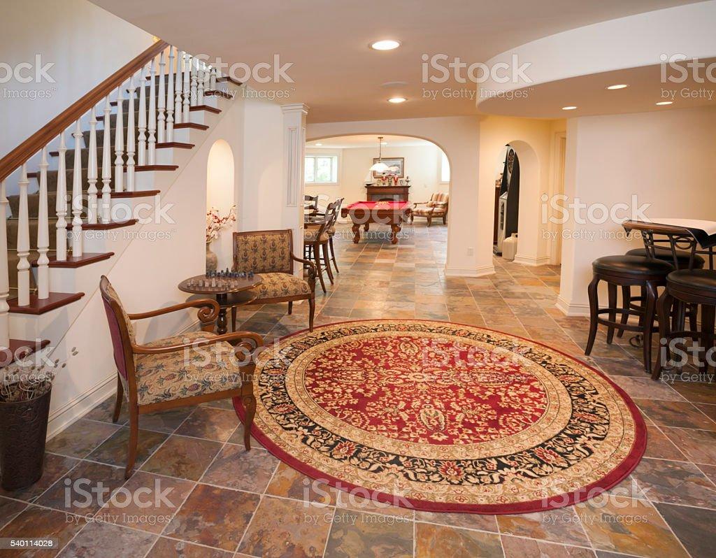 Exceptional finished basement with tiled floor, pool table stock photo