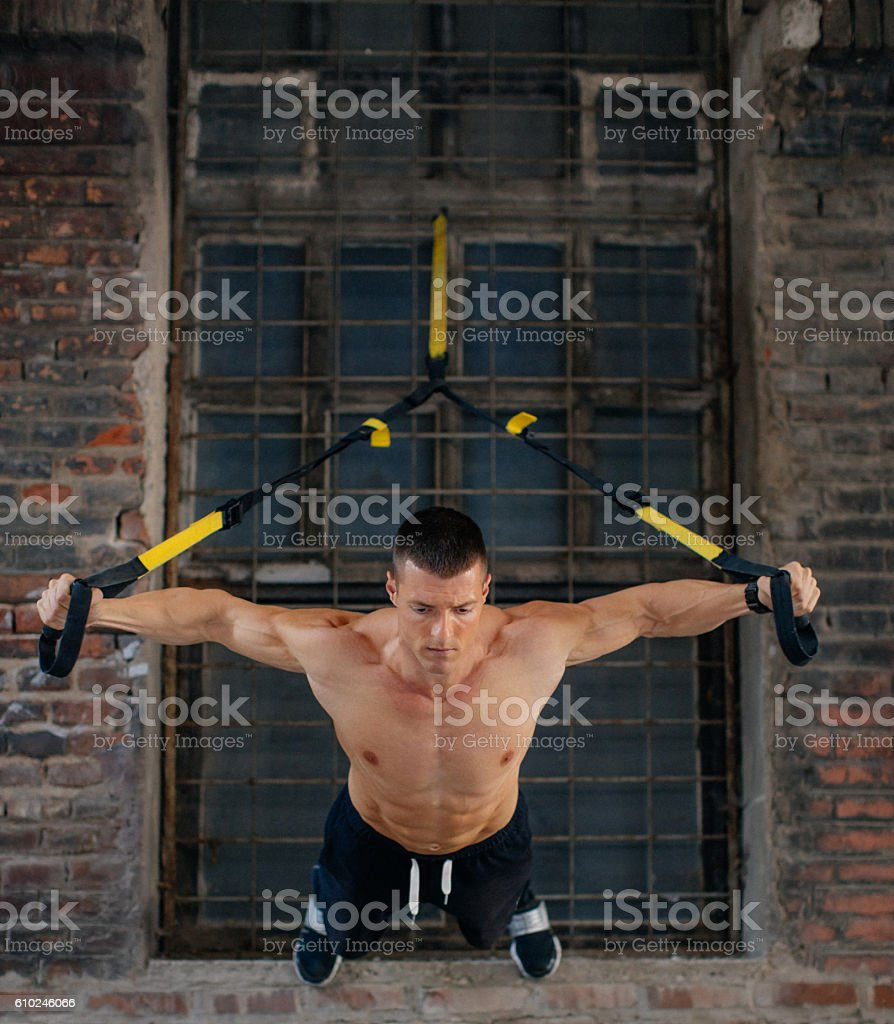 Excersising on suspension stock photo