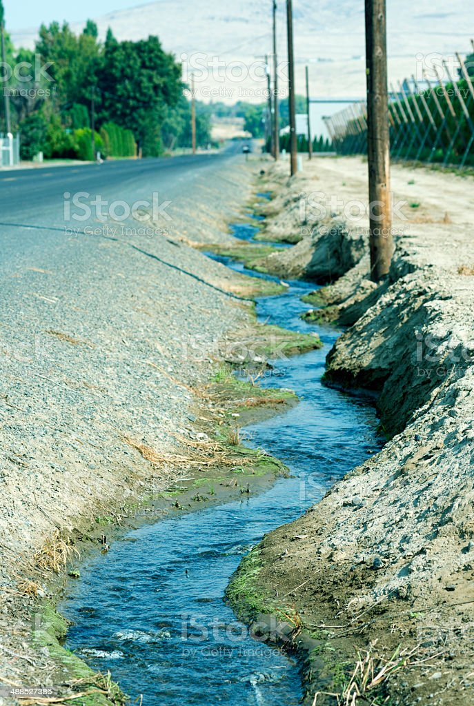 Excess irrigation water streaming in Yakima Valley WA stock photo