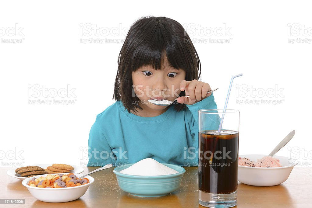 Excess Sugar: Child Eating Too Much Sweet Food stock photo