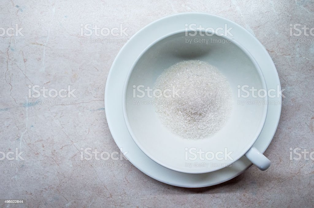 Excessive/Too Much Sugar in a Coffee/Tea Cup Overhead View royalty-free stock photo