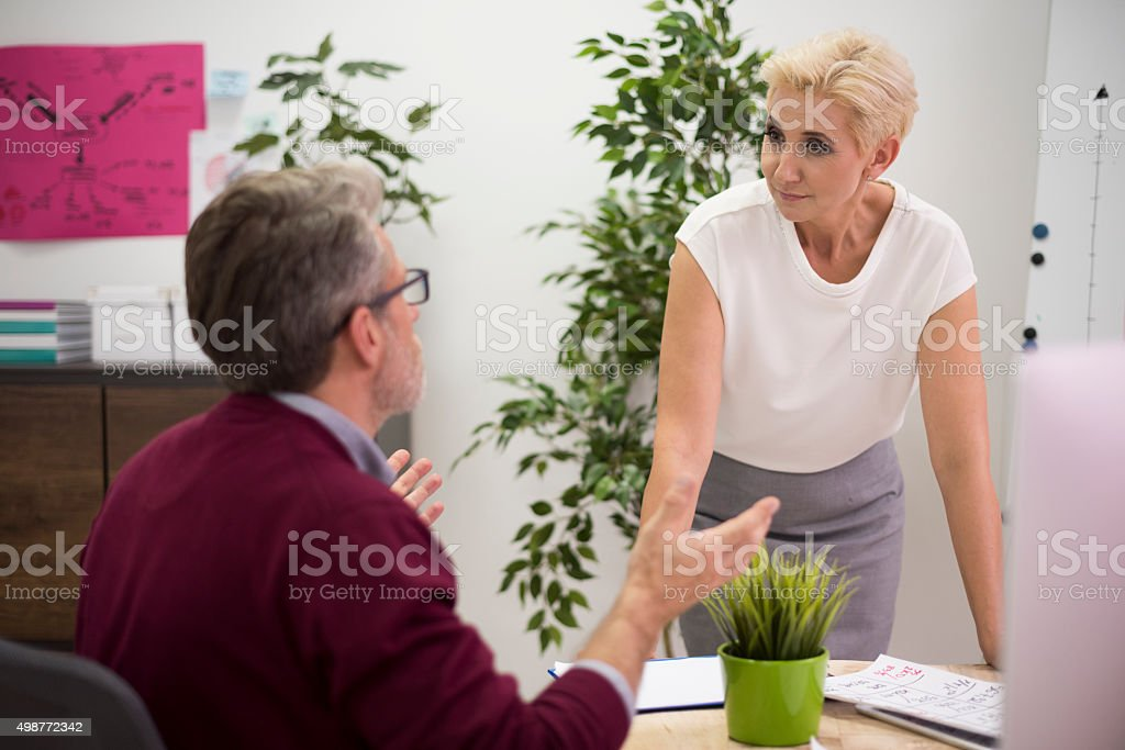Exchange of arguments between two workers stock photo