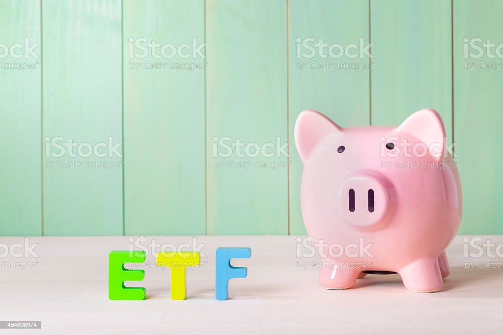 Exchange Traded Funds theme with piggy bank stock photo