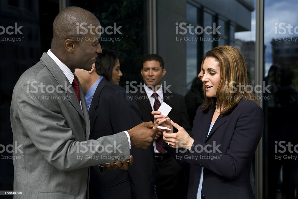 Exchanging business cards stock photo