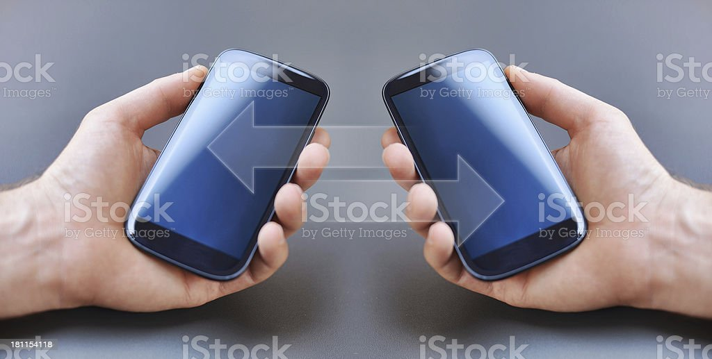 Exchanging Data with Mobile Phones royalty-free stock photo