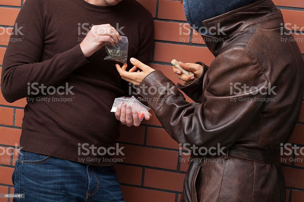 Exchanging drugs for money stock photo
