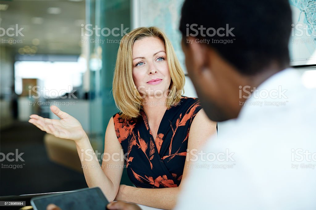 Exchanging ideas in the office stock photo