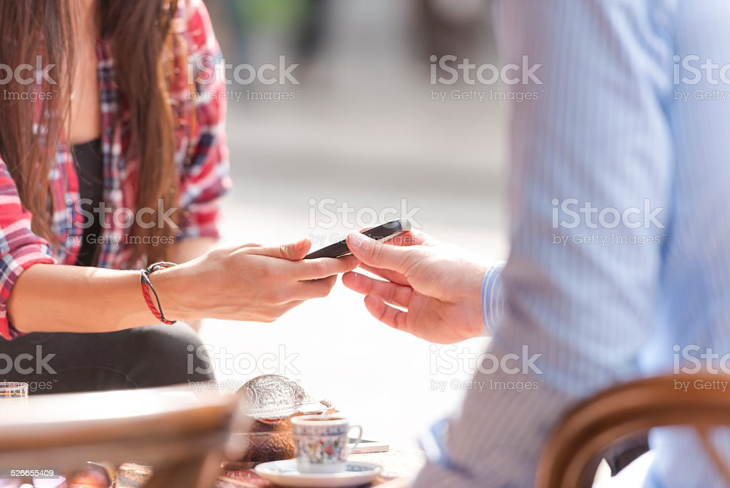 Exchanging numbers during a date stock photo
