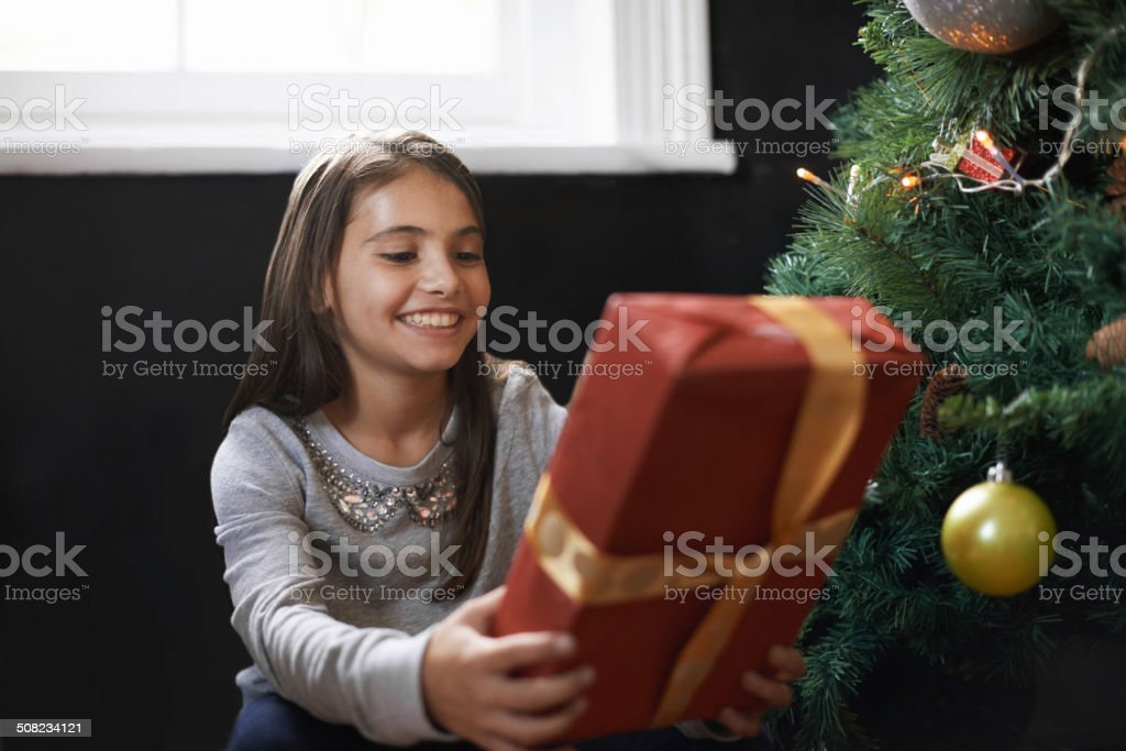 Excited about opening this present royalty-free stock photo