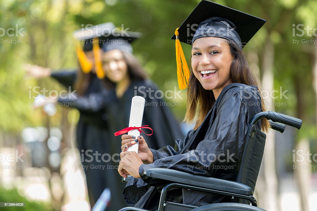 Excited African American college graduate stock photo
