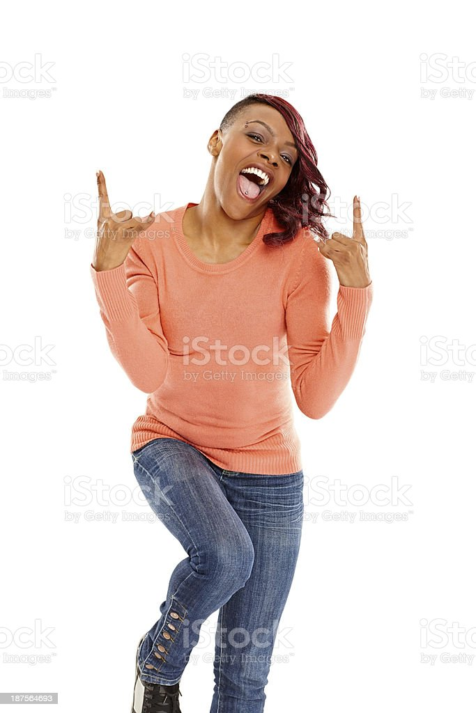Excited african lady gesturing rock and roll sign royalty-free stock photo