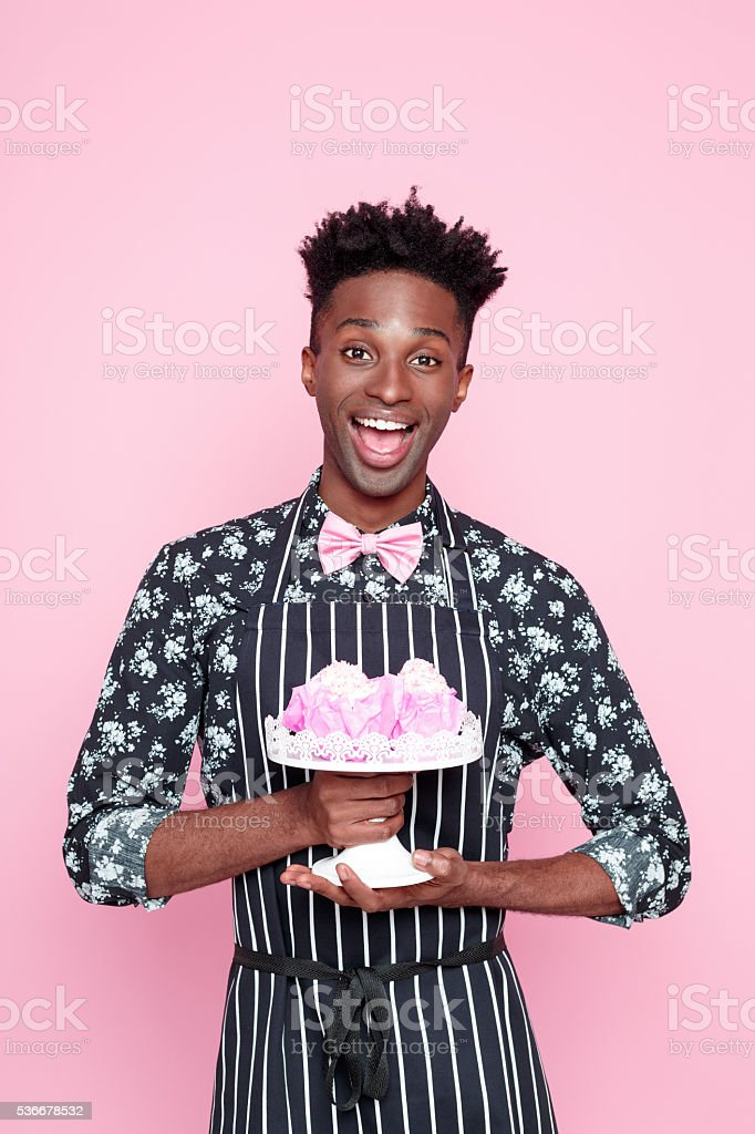 Excited afro american small business owner holding cookies stock photo