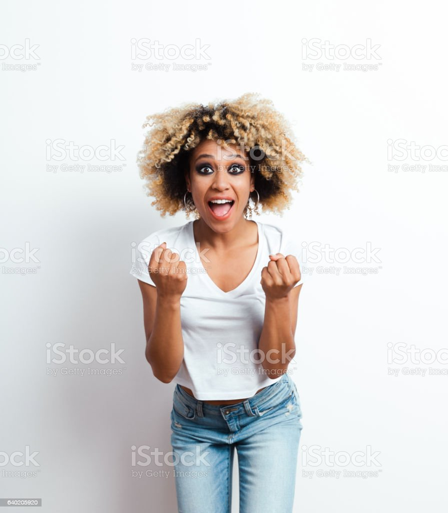 Excited afro american young woman stock photo