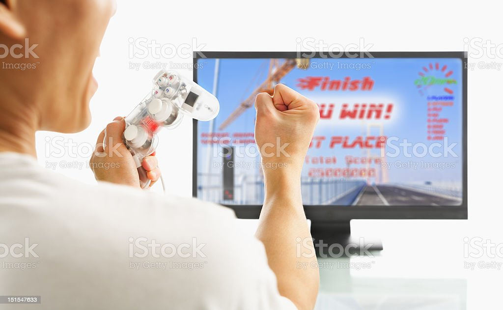 Excited after winning racing game royalty-free stock photo