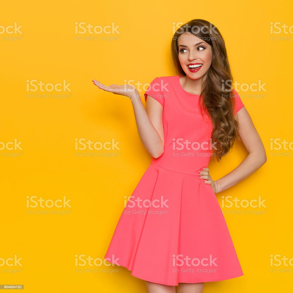 Excited And Happy Elegant Woman Presenting stock photo