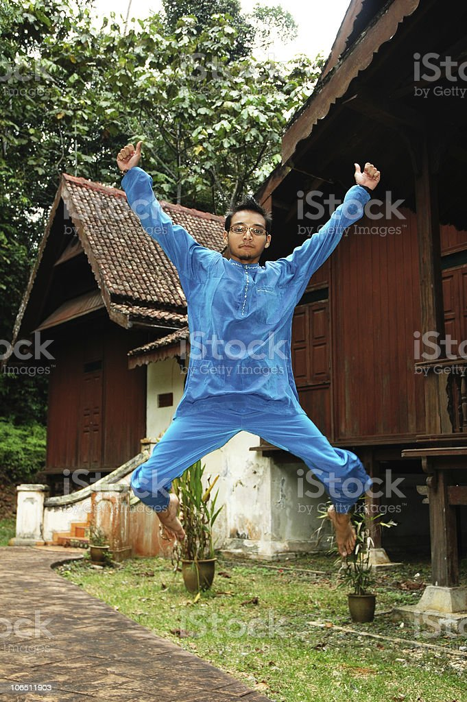 Excited Asian Malay Male in Traditional Costume royalty-free stock photo