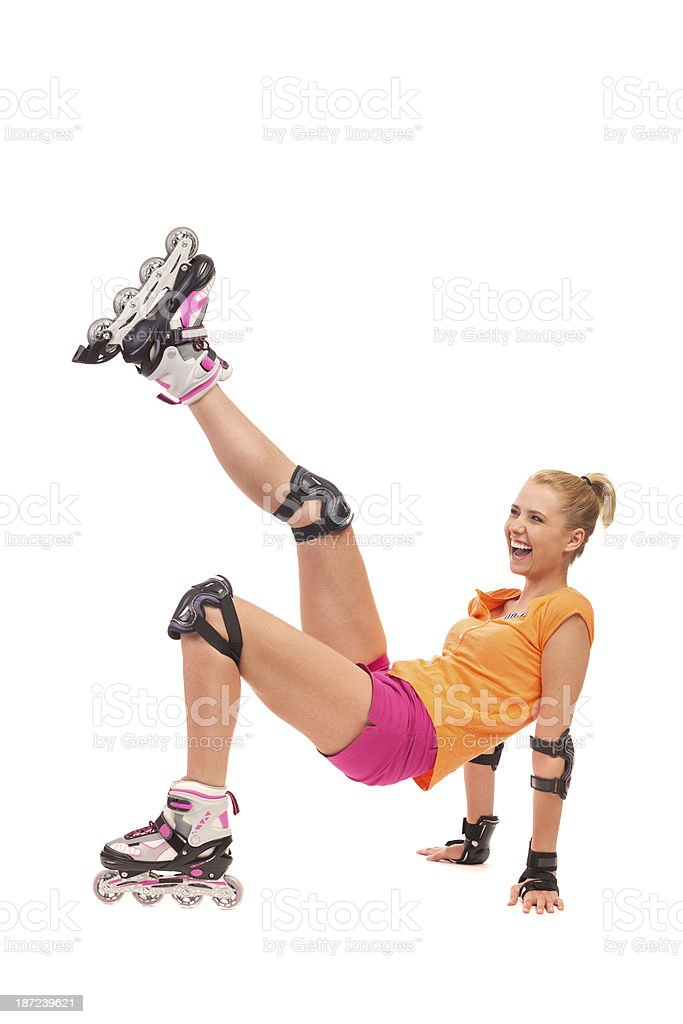 Excited attractive woman going rollerblading and kicking in the air. stock photo