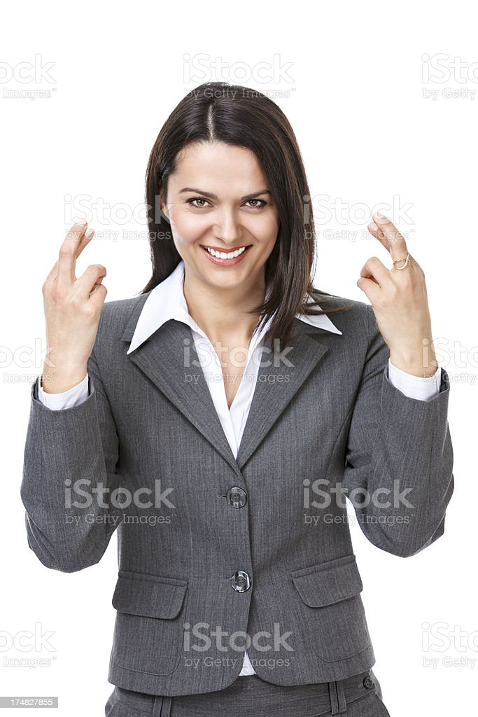 Excited beautiful businesswoman crossing her fingers royalty-free stock photo