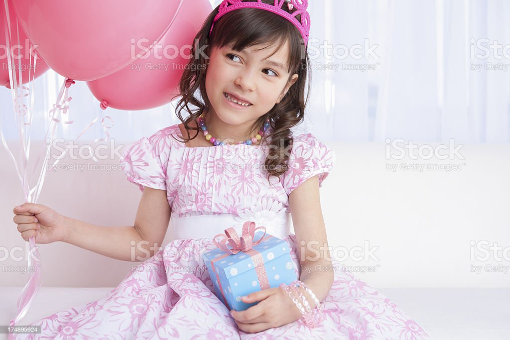 Excited birthday girl holding a gift royalty-free stock photo