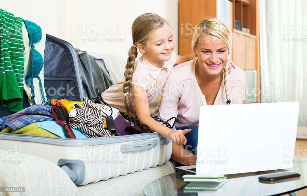 Excited blonde mother and little girl stock photo