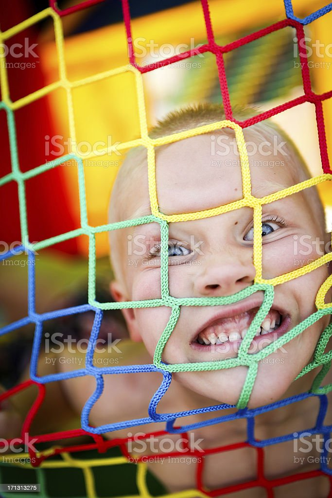 Excited boy in bounce house at a summer party stock photo