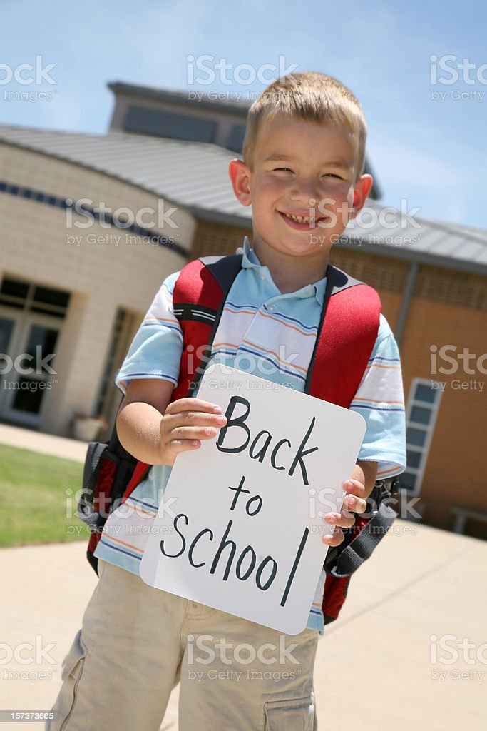 Excited Boy Returning to school royalty-free stock photo