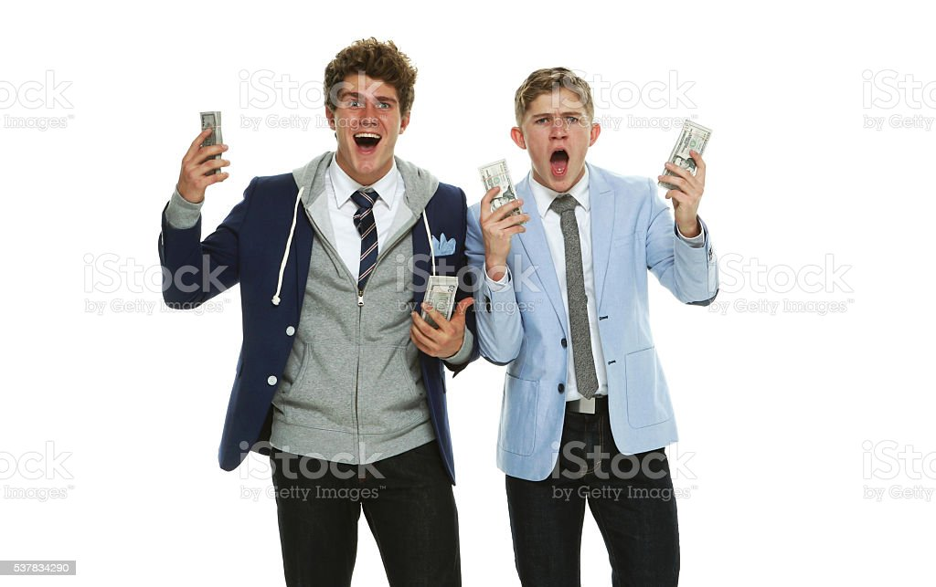 Excited brothers shouting with money stock photo