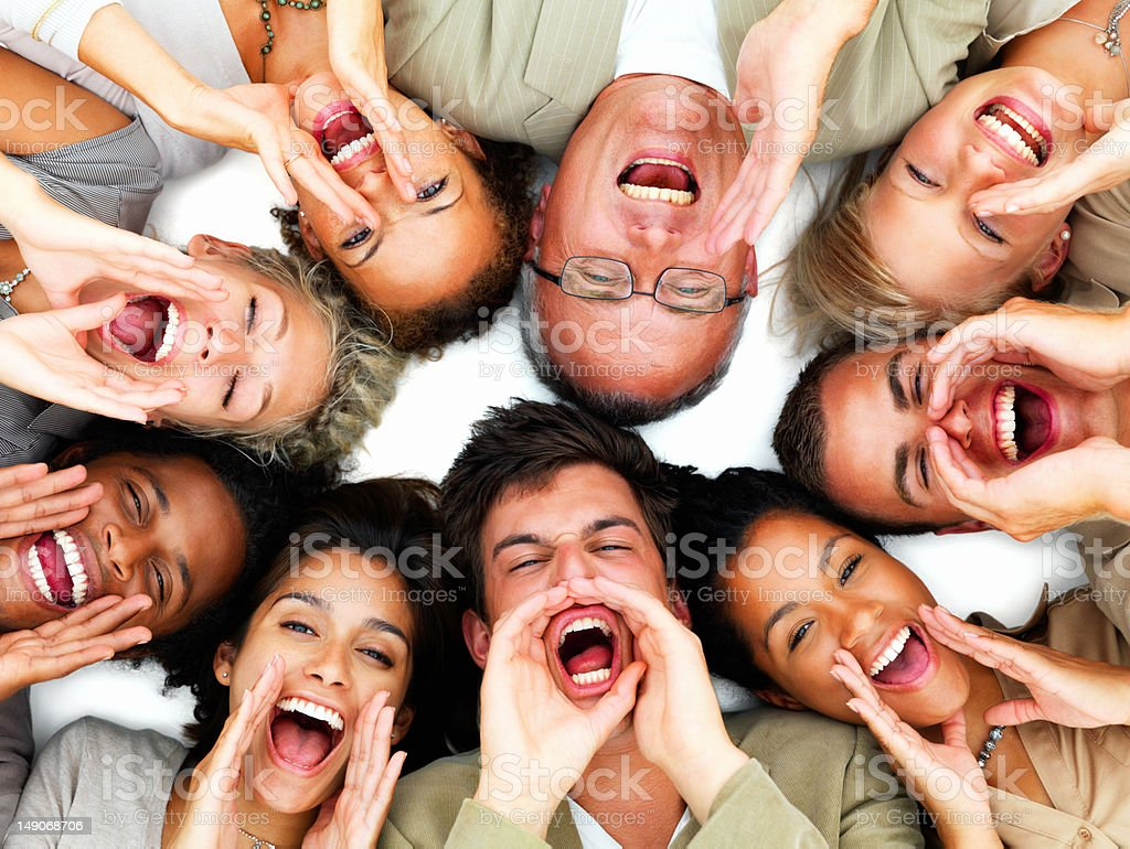 Excited business colleagues lying together on white royalty-free stock photo
