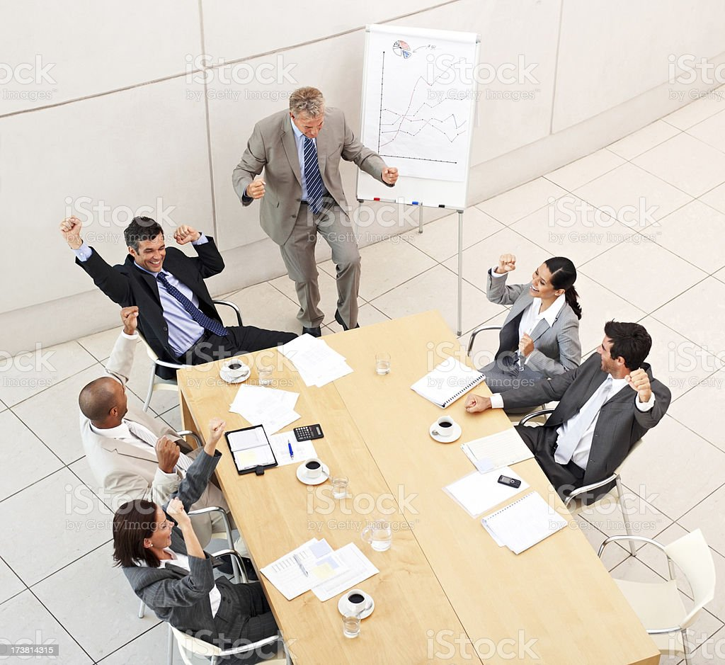 Excited business people at a meeting royalty-free stock photo