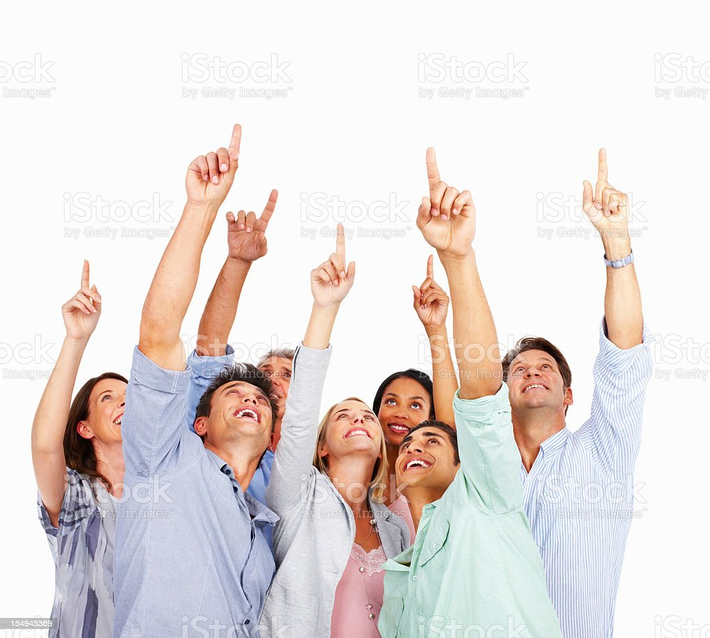 Excited business people pointing up stock photo