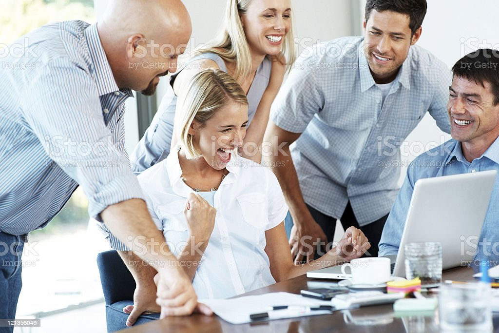 Excited business team enjoying their success in office royalty-free stock photo