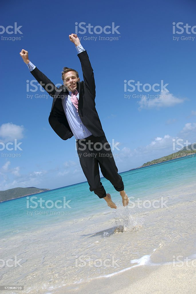 Excited Businessman Flying Like Superhero on Tropical Beach royalty-free stock photo